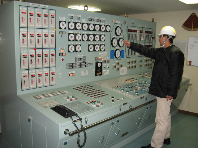 In a cargo control room monitoring gas cargo pressure